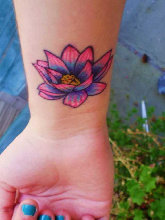 wrist hawaiian flower tattoo