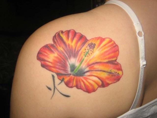 yellow hawaiian flower tattoo