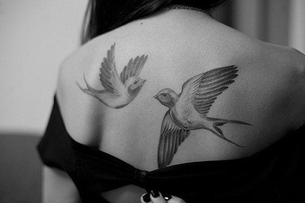 two flying doves upper back