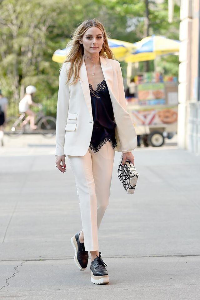 white suit with low v neck top
