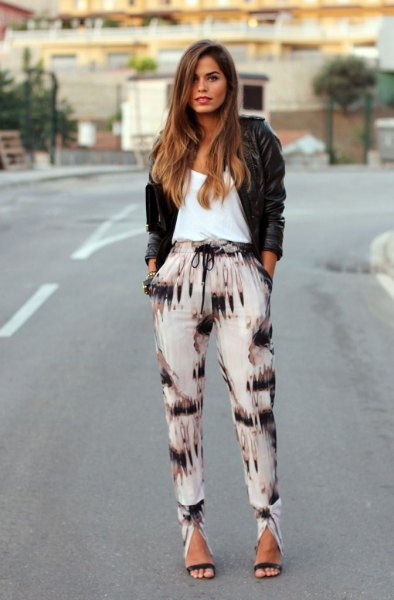 black and white pants black leather jacket