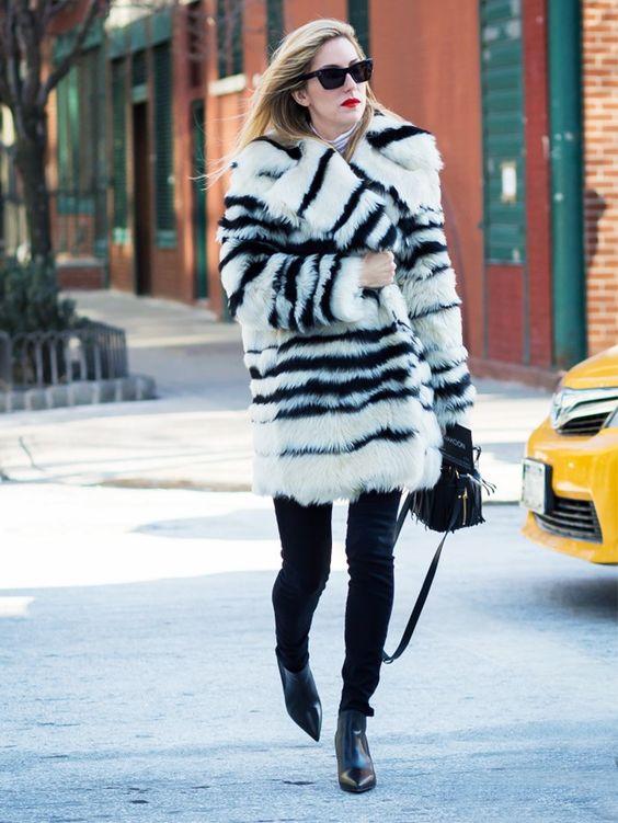 black booties jeans faux fur coat