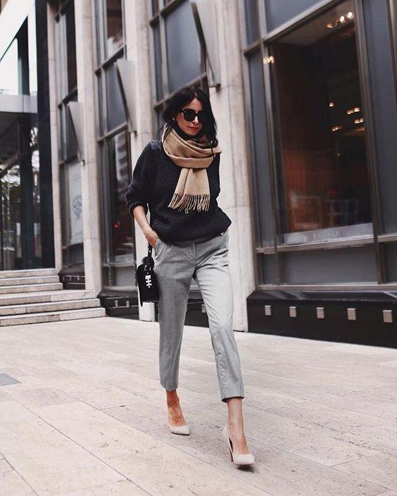 black sweater grey chinos