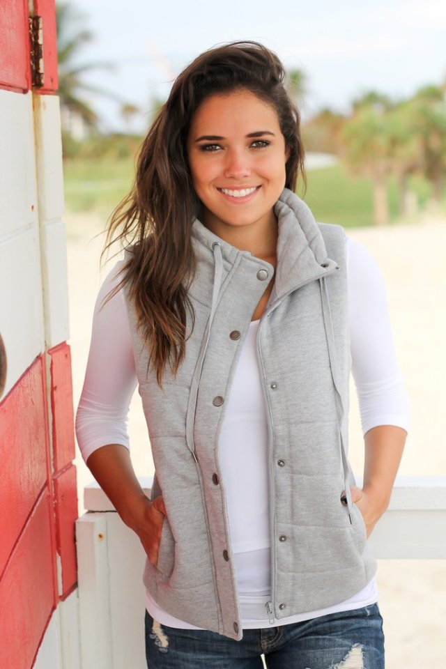 heathered grey quilted vest over white tee