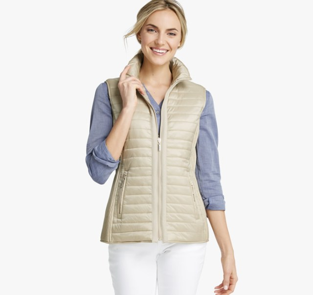 tan quilted vest over denim