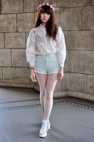 white embroidered shirt with striped white shorts