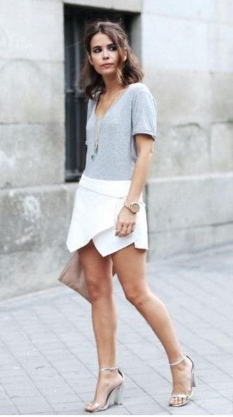 white skort grey t shirt necklace