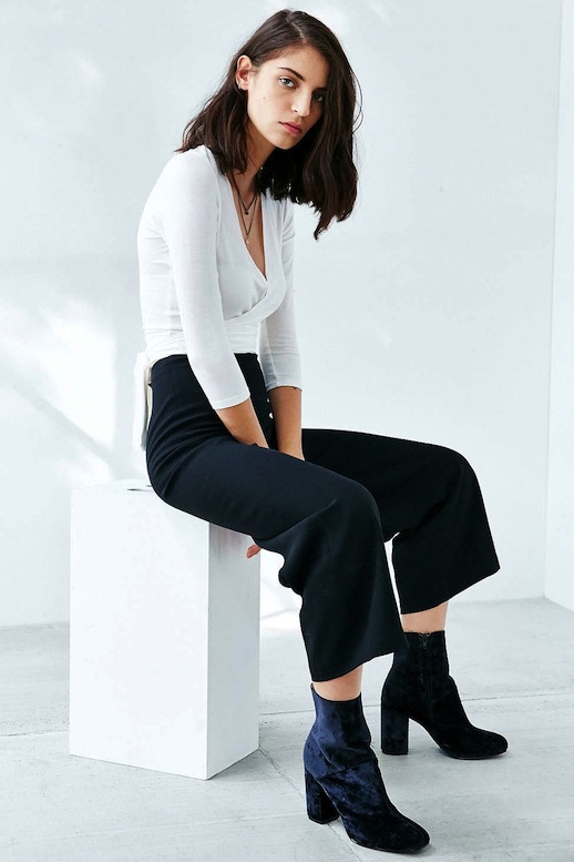 white top black wide leg pants ankle boots