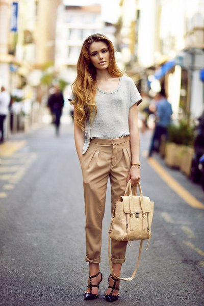beige pants black strappy heels