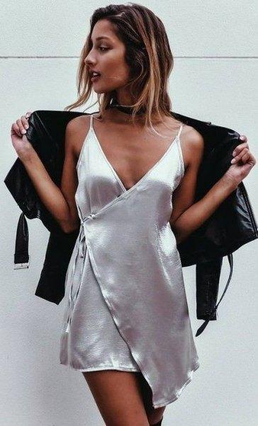 black cardigan over silver silk wrap mini dress