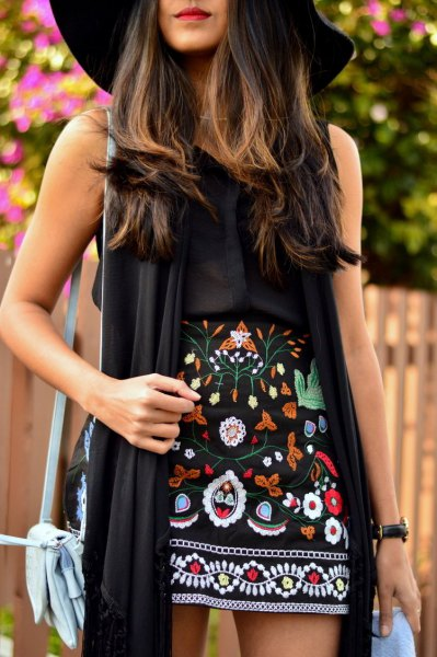 black long vest floppy hat outfit