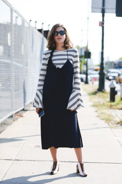 black slip dress over striped bell sleeve top