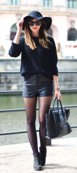 floppy hat black leather shorts