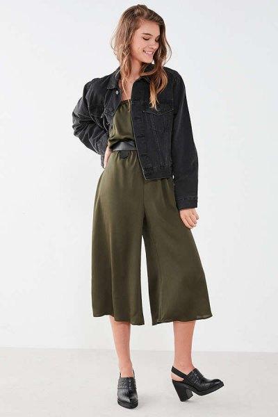 green jumpsuit black denim jacket