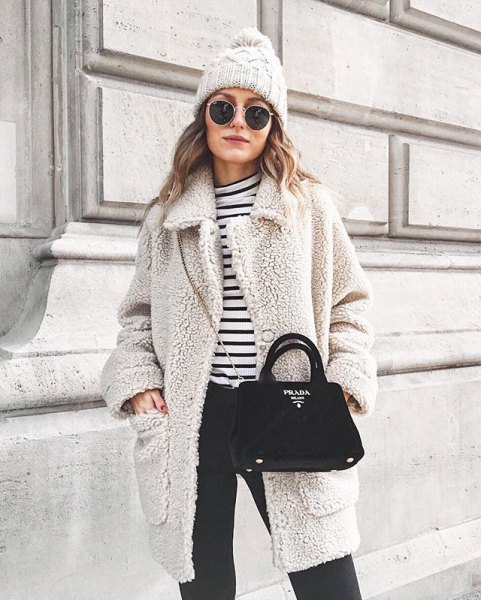 grey teddy coat with black and white striped t shirt