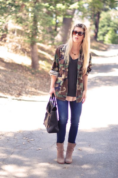 grey v neck top ankle boots camo jacket