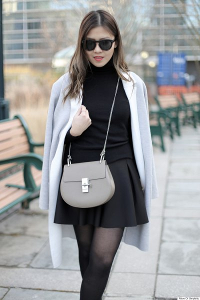 grey wool coat over shoulder black skater skirt