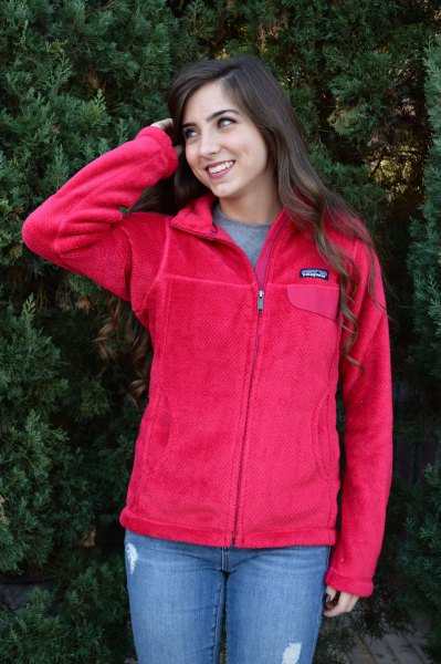 red fleece jacket with jeans