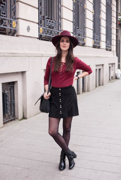 red lace up top black button front skirt