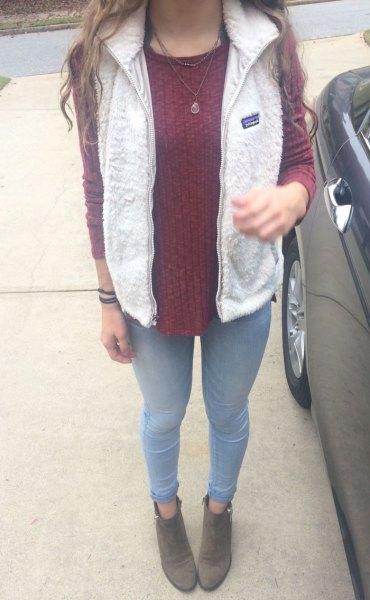 white fleece vest grey knit sweater sky blue jeans