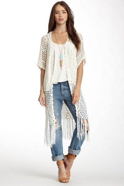 white long crochet vest white tee cuffed jeans