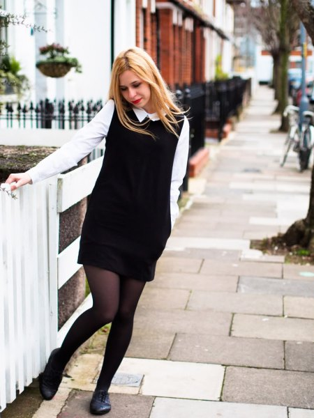 white shirt black sleeveless knit sweater dress oxford shoes