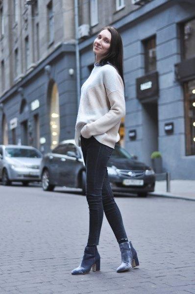 white sweater black skinny jeans