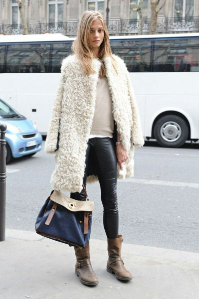 white teddy coat draped over shoulders leather leggings