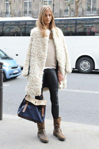 white teddy coat draped over shoulders leather leggings