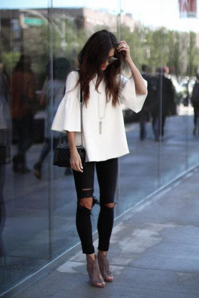 white woven ruffle top black ripped jeans