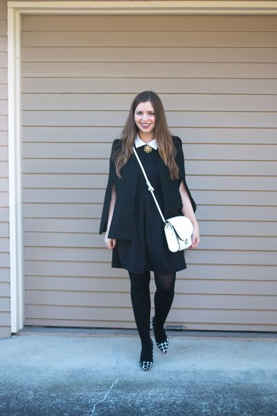 black dress blazer draped over shoulders