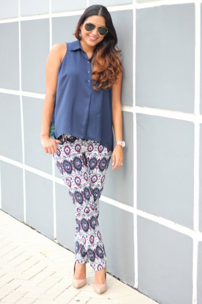 blue sleeveless button up blouse white tribal printed pants