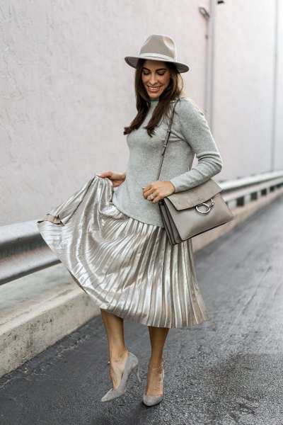 grey form fitting long sleeve tee silver skirt