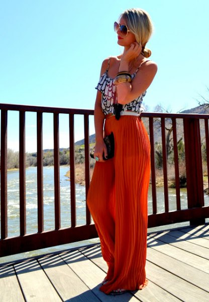red pleated pants black and white printed vest top