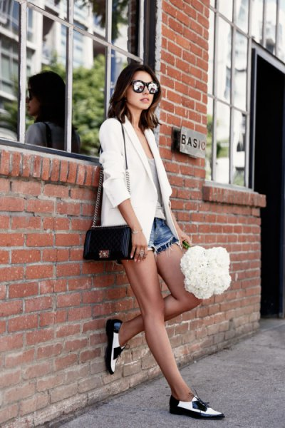 white blazer denim shorts white and black loafers