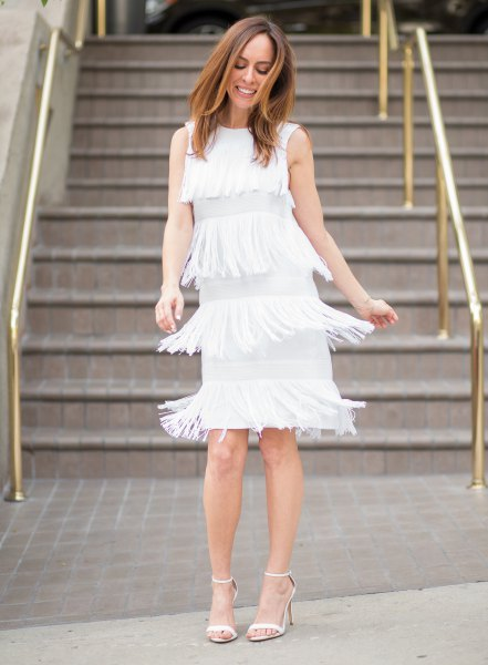 white dress multiple layers of fringes