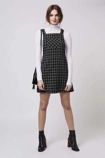 white high neck sweater black printed pinafore skater dress