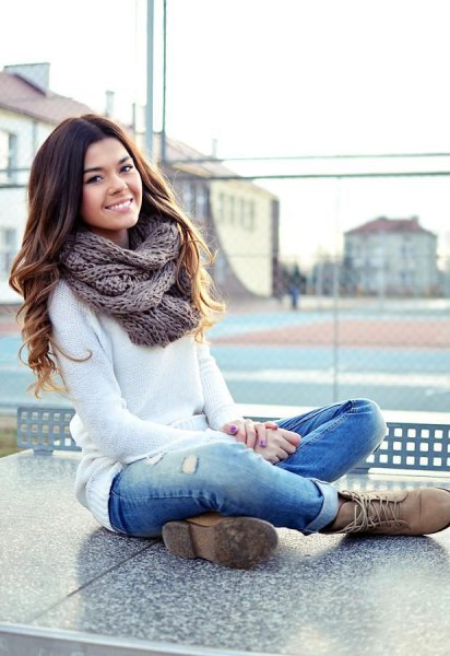 white knit sweater cuffed jeans