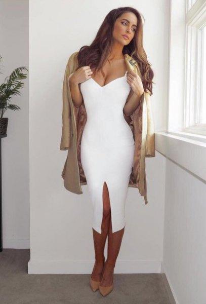 white midi dress camel coat draped over shoulders