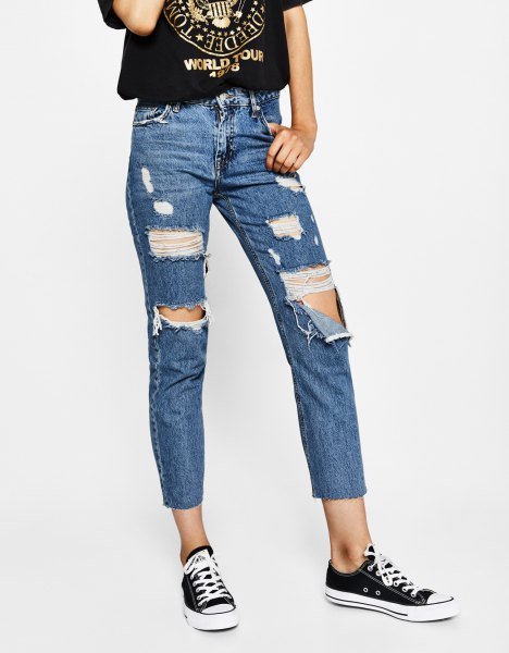 black print tee ripped blue jeans