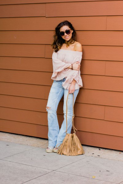 blush pink off shoulder blouse flared jeans