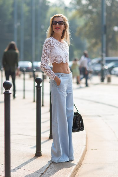 cropped white long sleeve lace top sky blue wide leg jeans