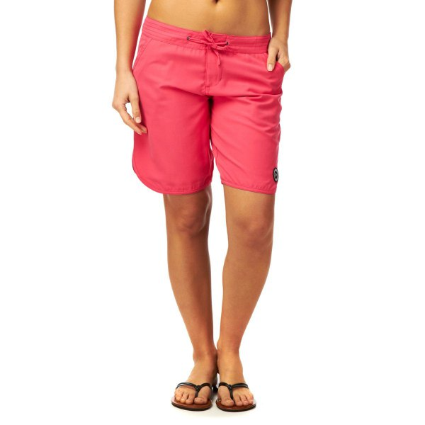 neon pink long shorts black sandals