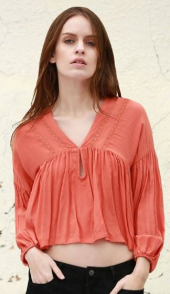 orange cropped puff sleeve v neck blouse