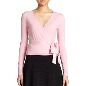 pale pink wrap sweater black skater skirt