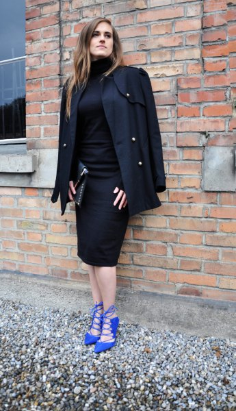 royal blue heels black coat draped over shoulders