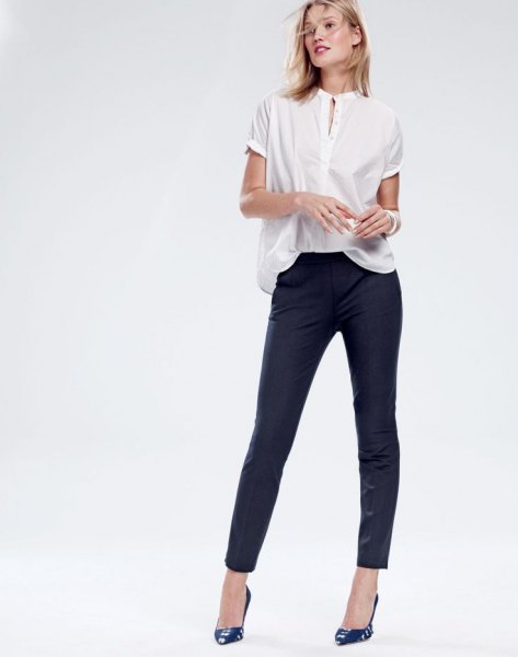 white popover shirt black skinny pants