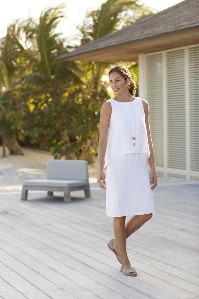 white sleeveless two layered knee length dress