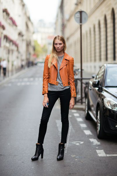 yellowish brown leather jacket grey tee jeans