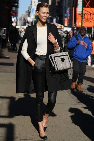 black cape coat white top leather pants